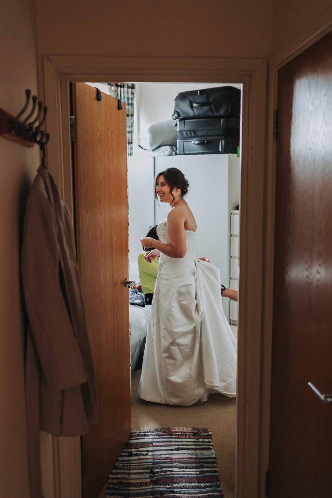 bride in dress in doorway
