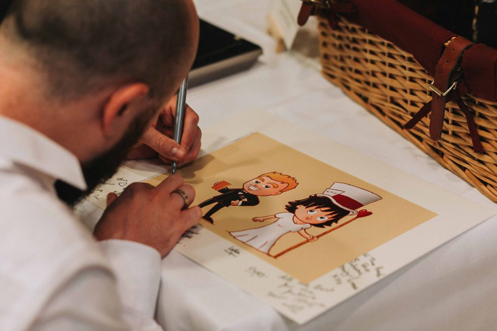 guest signing picture and frame at Canterbury Cathedral lodge wedding