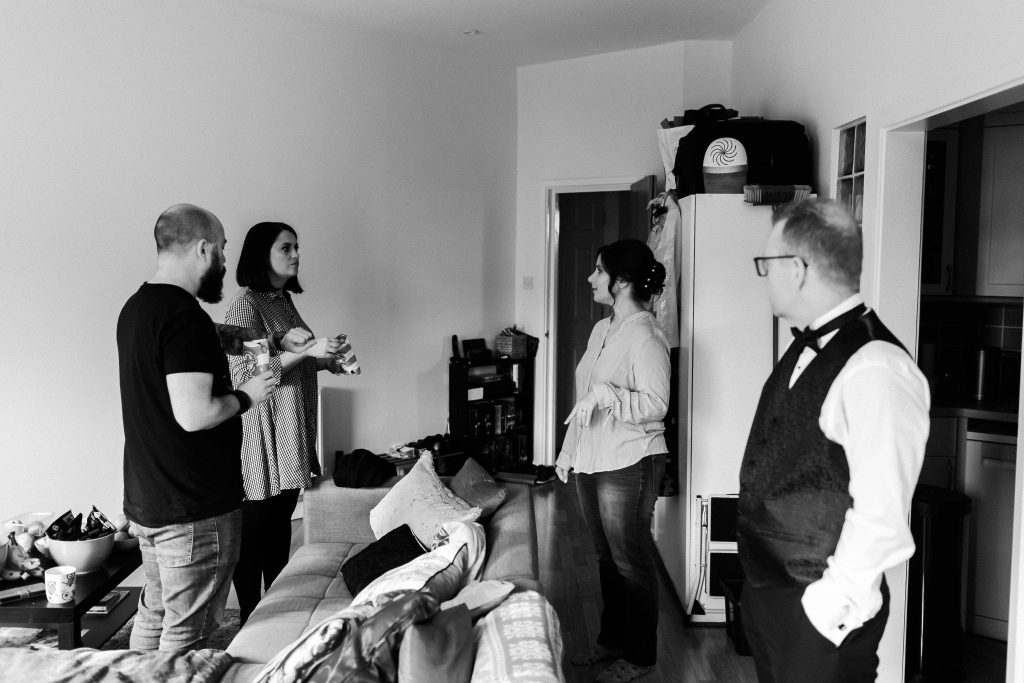 bride and groom with friends during wedding prep