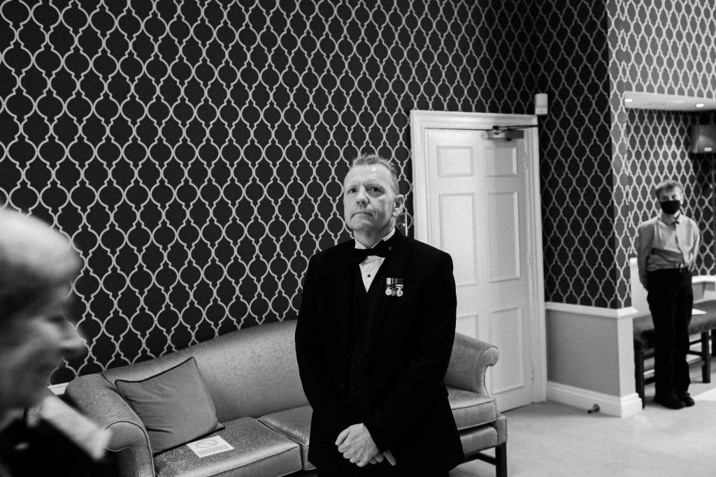 groom waiting for bride entrance to wedding ceremony