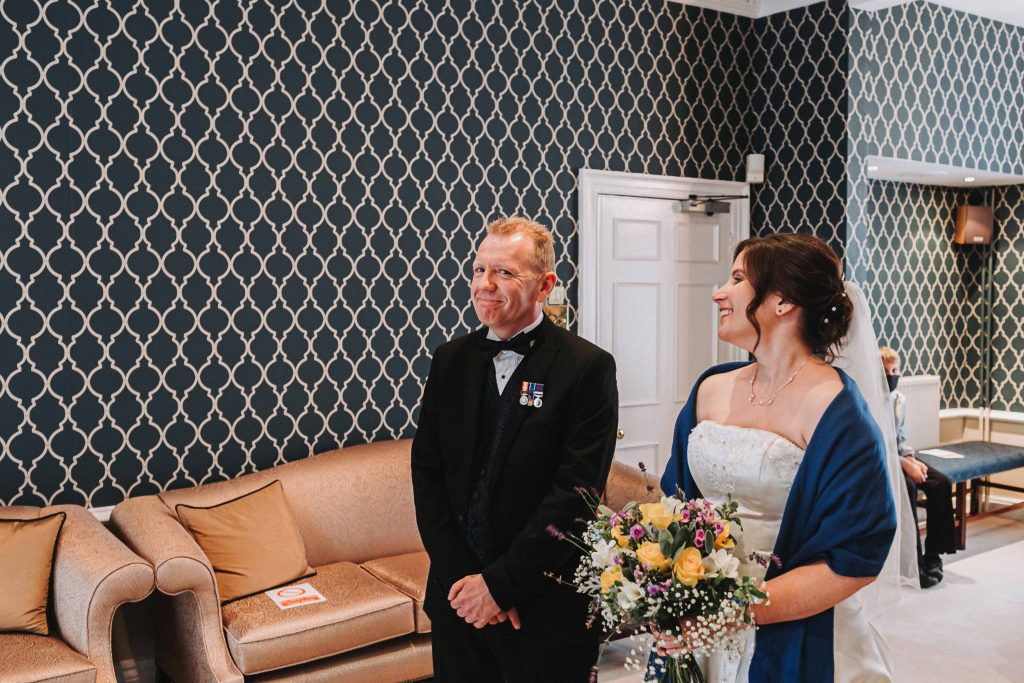 bride and groom during wedding ceremony at registry office