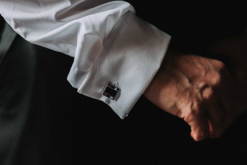 detail shot of cufflinks on groom