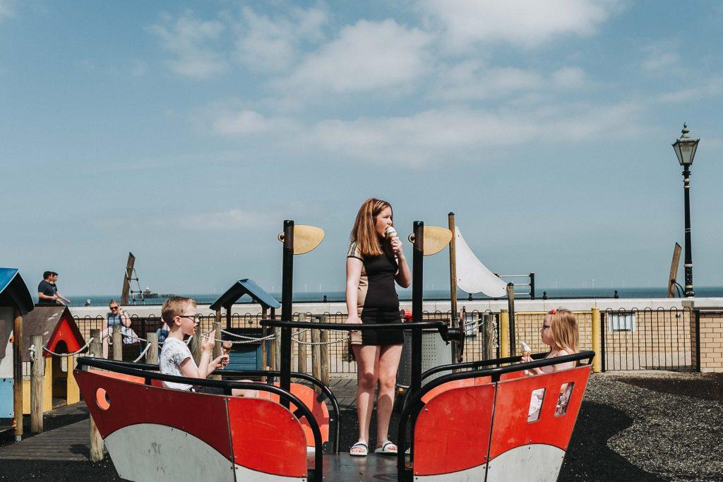children in play park on boat for pre-wedding family shoot