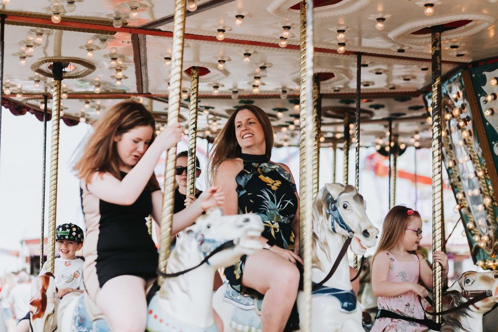 mum and daughters on carousel on herne bay pier