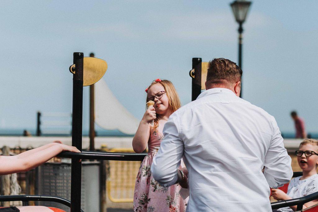 girl admiring her ice cream on a family pre wedding shoot